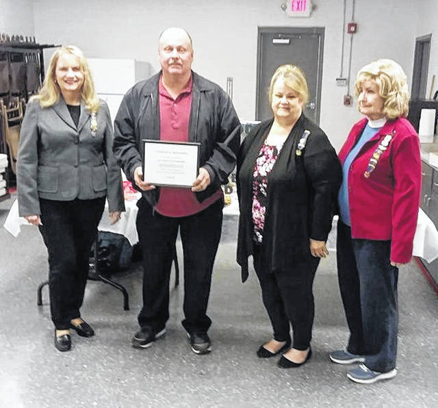 Pictured left to right: Beth Normand, Fire Chief Miles Horsley, Mary Crist and Naomi Shewman