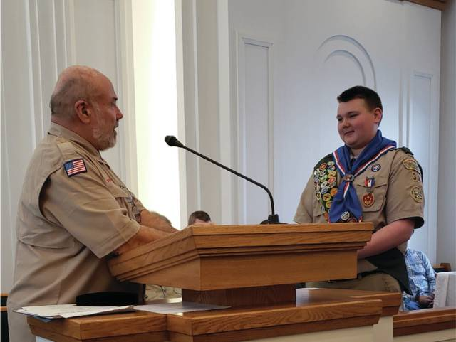 Scoutmaster Maynard happily presented Nathan as an Eagle Scout.