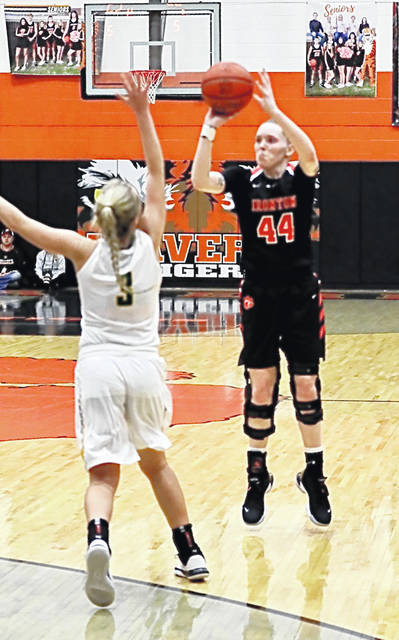 Ironton senior Lexie Arden (44) attempts a shot over North Adams senior Mary Sonner (3) during Saturday's Division III girls basketball district championship game at Waverly's Downtown Arena.