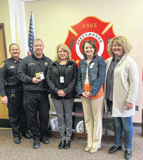 Left to Right: Debbie Brewer, Acting Portsmouth Police Chief, Michael Sines - Captain Portsmouth Fire Department, Becky Montgomery, Jennifer Montgomery, and Rhonda Porter with Adult Protective Services