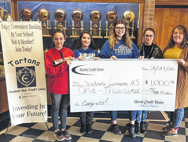 Tartans Student-Run Credit Union Receive $1,000 for their school.