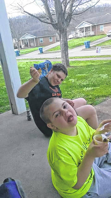 Mollie and Leo Morrissette from West Portsmouth, enjoying the lunches delivered by their school. These kids are not Valley Local School kids, but they are a perfect example of how the delivery of food to school kids all over Scioto County is important at this time.