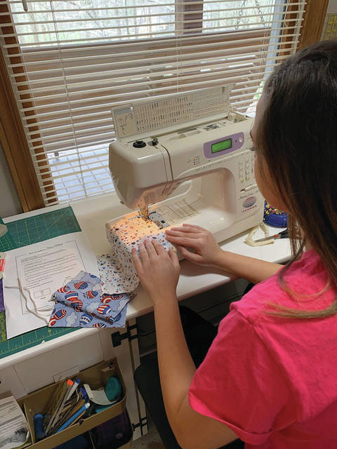 Felicity Pettay sewing masks for healthcare providers who might need them after running out of masks.