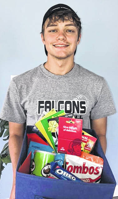 Andy Crank, a senior at Minford High School displaying his Adopt a Senior gift.