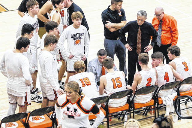 Portsmouth West boys basketball coach Bill Hafer, shown here instructing his Senators during a game last season, will not be returning as head coach next season.