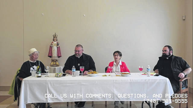 (Pictured L-R:) Nancy Enzie, Father Joe Yokum, Barb McKenzie, and Father Christopher Tuttle of Scioto Catholic and the St. Francis Outreach Center held a COVID-19 conversation, cocktail hour, and call-in donation show to help benefit the Outreach Center's food pantry during the coronavirus pandemic.