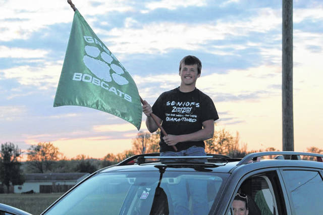 <em>Trevor Darnell of Green High School celebrated his senior year at a community parade on Monday, April 21.</em>