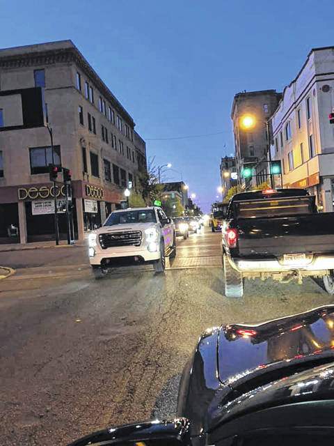 A view of Chillicothe Street in downtown Portsmouth Saturday, April 18 as local citizens partake in a cruise while adhering to federal social distancing guidelines amid the COVID-19 pandemic.