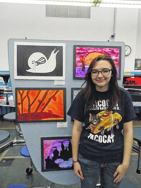 A student at Sciotoville East High School showcases her work during a previously held art show for Tartan students.