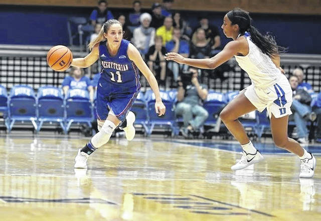 Presbyterian College's Kacie Hall, a former South Webster High School girls basketball standout, competes against Duke during a women's college basketball game during her freshman season. `