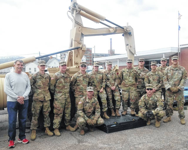 Left back- Mark Hunter with the members of the National Guard who delivered food for the Steven A. Hunter Power Pack Program.