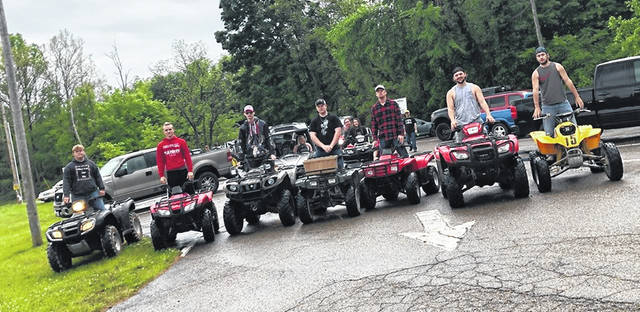 A group of some of the Minford graduating senior riding their 4 wheelers in the final senior ride (Bryson Ashley in red sweatshirt)