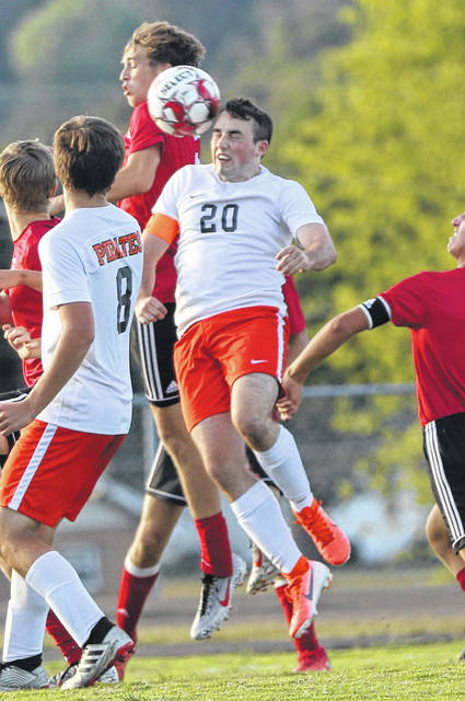 2020 Wheelersburg graduate Brady Warren attempts a header from a corner kick from a Pirate teammate during a game in the 2019 regular season.