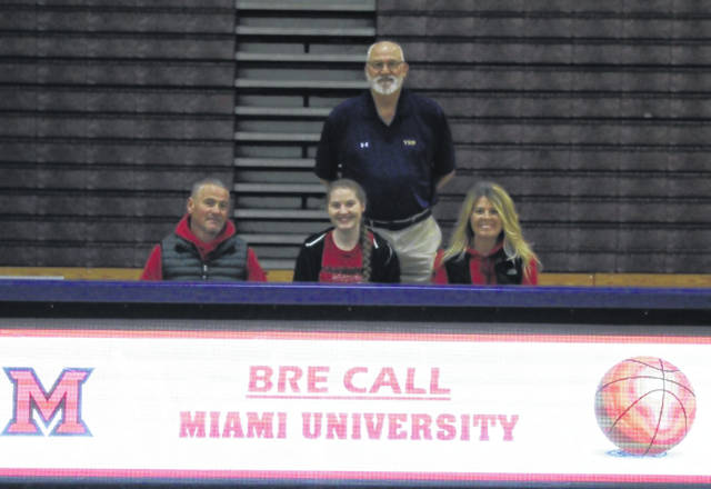 Valley High School senior Bre Call, seated center, announces her intention to play college basketball with Miami University-Hamilton. Seated with Call are father Rob Call (left) and mother Lisa Call (right). Standing is former Valley High School girls basketball head coach Mark Merritt.