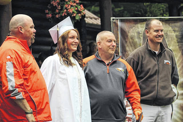 (Left to right) Eastern High School Assistant Principal-Grant Stephan, Eastern 2020 Graduate-Kaytlyn Newsome, Eastern Superintendent-Neil Leist and Eastern High School Principal-Robie Day at Kaytlyn's graduation at her home.