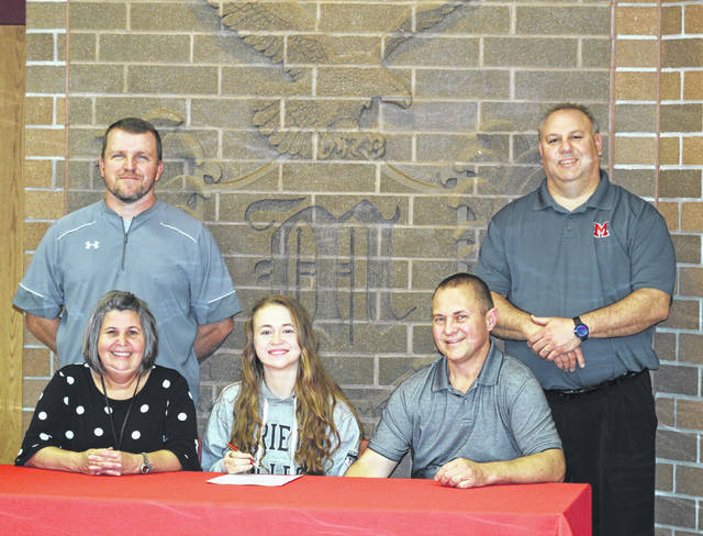 Minford High School senior Faith Malone, seated center, announces her intention to run college track and field at Marietta College. Seated with Malone are mother Robin Malone (left) and father Tim Malone (right). Standing are Minford High School girls track and field coach Chuck Miller (left) and Minford High School Principal Jeff Pica (right).