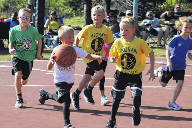 Players participate in a McGraw League basketball game during September 2019, the 30th straight year in which the league has given kids and teens from the Tri-State Area a place to spend their summers playing the game they love.
