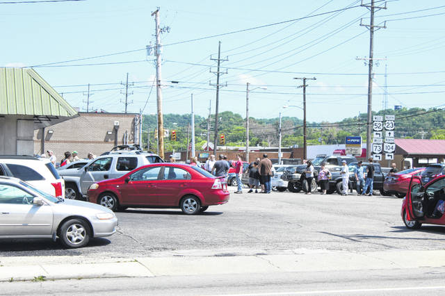 Patrons await their entry into the Bureau of Motor Vehicles (BMV) location at 843 11th Street, Portsmouth.