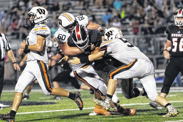 2020 West senior Joe Igaz (60) helps gang-tackle a Coal Grove runner during the Senators 21-12 road win over Coal Grove back on September 13, 2019.