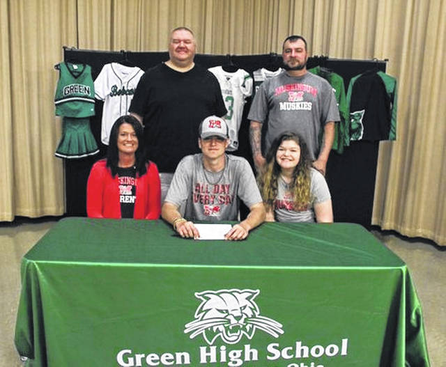 Green High School senior Mason Hensley, seated center, announces his intention to play college football for Muskingum University. Seated with Hensley are mother Jamie Hensley (left) and sister Alley Hensley (right). Standing are former Green High School head football coach Ted Newsome (left) and father Timothy Hensley Jr. (right).