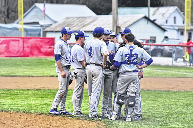 Former East baseball, football and girls basketball coach Matt Miller talks with his team during a road baseball game versus Symmes Valley at the start of the 2019 season.