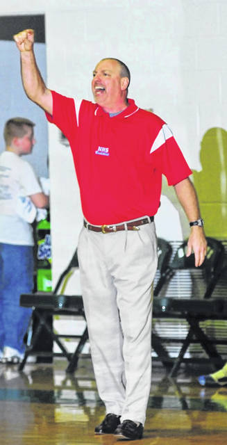 Rick Scarberry, pictured here coaching the Northwest Mohawks during a game a decade ago, was rehired on Tuesday night as Northwest's new boys basketball head coach.