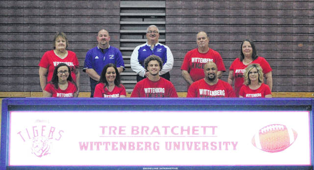 Valley High School senior Tre Bratchett, seated center, announces his intention to play college football for Wittenberg University.