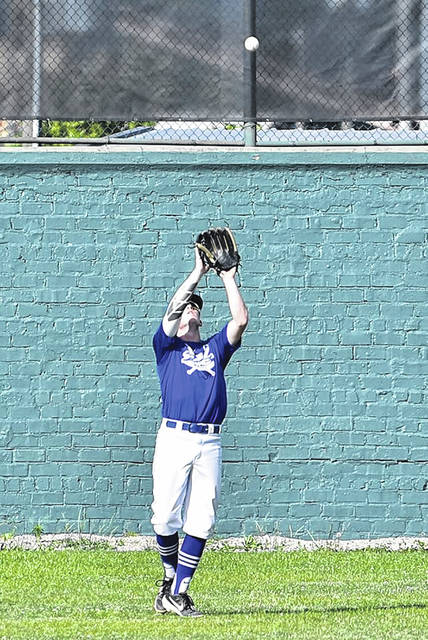 Portsmouth Post 23 Seniors center-fielder Case Dyer makes a catch during their game against the Huntington Hounds at Branch Rickey Park.