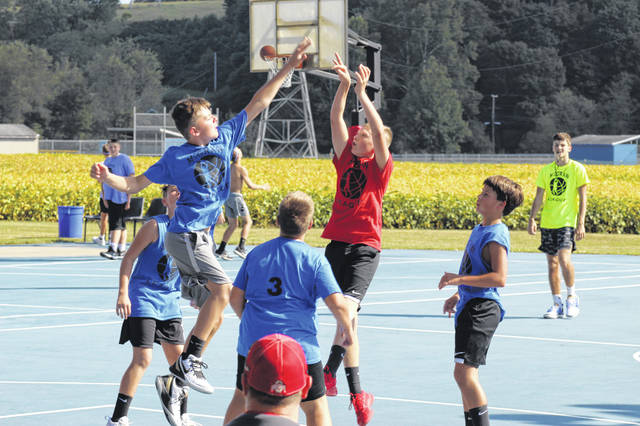 Players in the Fall 2019 McGraw Basketball League play in a game at the McGraw League courts located just off State Route 140.
