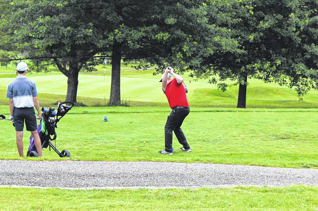 Minford graduate Matthew Koverman tees off during his round as part of the Tri-State Junior Golf Tour's visit to the Elks Country Club in McDermott.