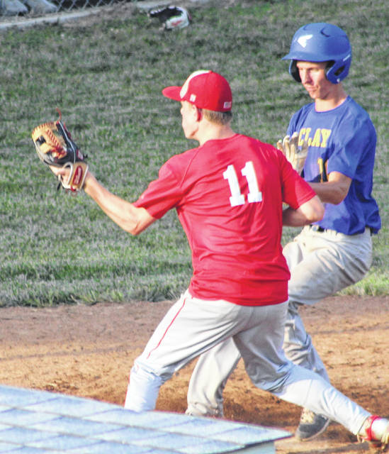 Clay's Carson Porginski (16) scores a sixth-inning run in front of Minford pitcher Cole Borland (11) during Monday's Scioto County high school baseball league game at Clay High School.