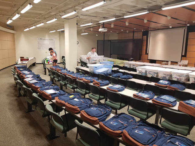 The Upward Bound Math & Science team at Shawnee State University prepare boxes of supplies for students participating in the program remotely this summer.