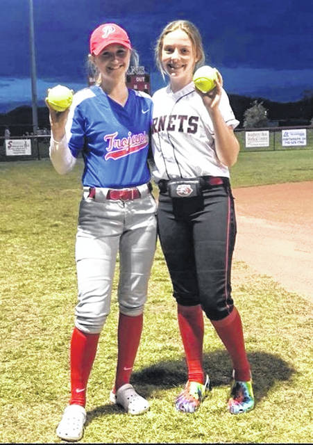Portsmouth's Madison Perry (left) and Coal Grove's Addi Dillow (right) are members of the West Virginia Dusters softball travel team.