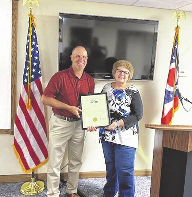 State Representative Brian Baldridge presents Kim Carver with a proclamation from the State of Ohio recognizing her dedicated service to the citizens of Ohio.