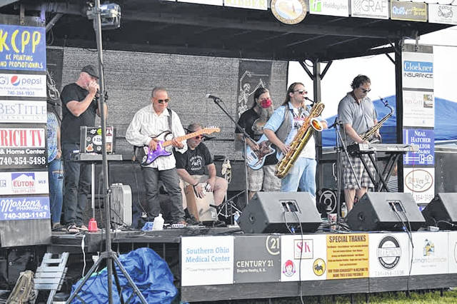 During the Final Friday in Boneyfiddle June show, the lead act, Mothman, performs at Final Friday's Three Bridges Outdoor Music Venue.