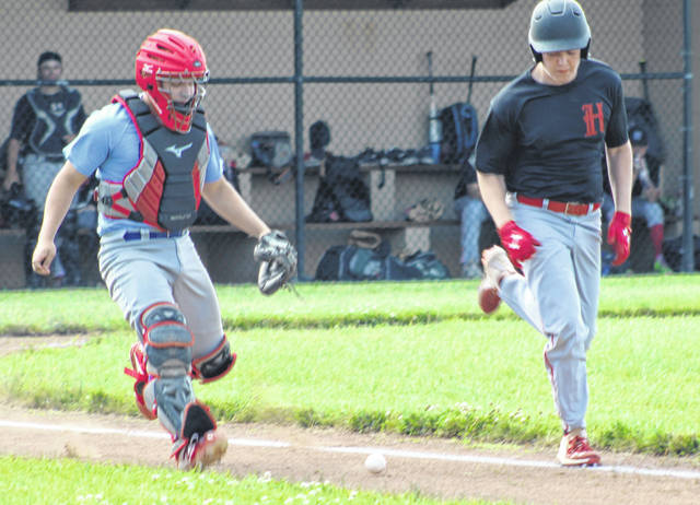 Caeleb McGraw, the Portsmouth Post 23 Juniors catcher and son of head coach Josh McGraw, tracks down a foul ball during their game against Hillsboro earlier this summer.