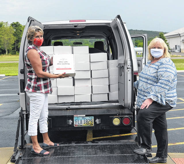 Left to right:Katy Farber, Ohio SE Economic Development Vice President and Lisa Carver, the Executive Director of the Portsmouth Area Chamber of Commerce loading the kits.