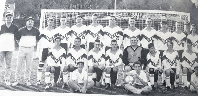 Don Lewis, standing in back far right, coached the 1992 New Boston Tigers boys soccer squad. Lewis, a legendary coaching figure for Southern Ohio Conference soccer, passed away last Friday.