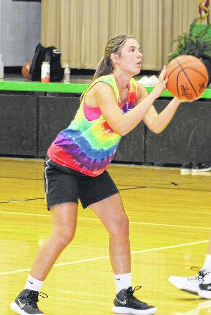 Green's Kaitlin Satterfield attempts a shot during a recent Lady Bobcats' summer workout.