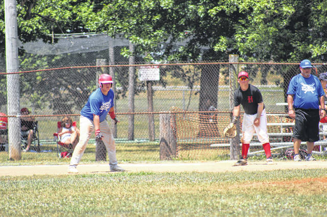 Post 23's Isaac Doolin leads off of first base in Portsmouth's 9-7 win over Hillsboro in Saturday's first game of the Junior Legion Regional Torunament.