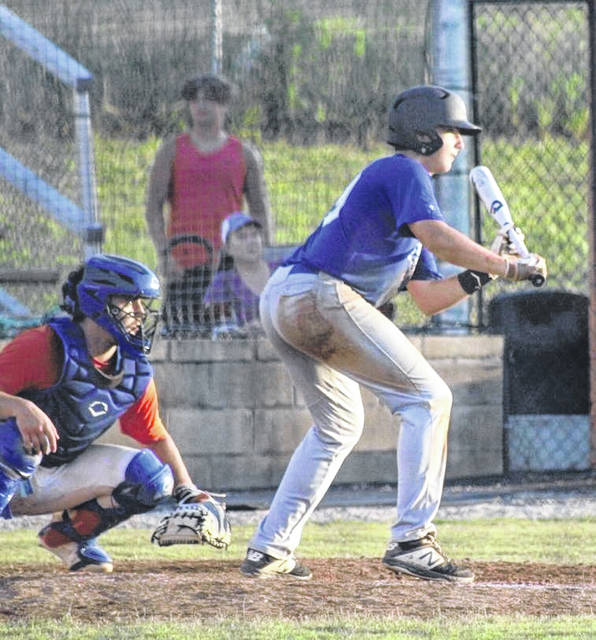 Portsmouth Post 23's Landon Jones goes for a bunt during the Juniors' baseball game at Raceland on Wednesday.