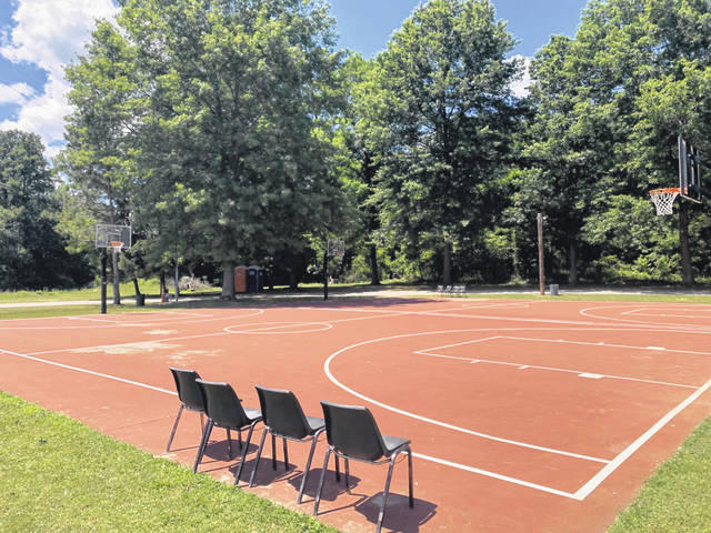 The McGraw League outdoor basketball courts are the home of Scioto County's newest yoga class, Yoga on the Courts.