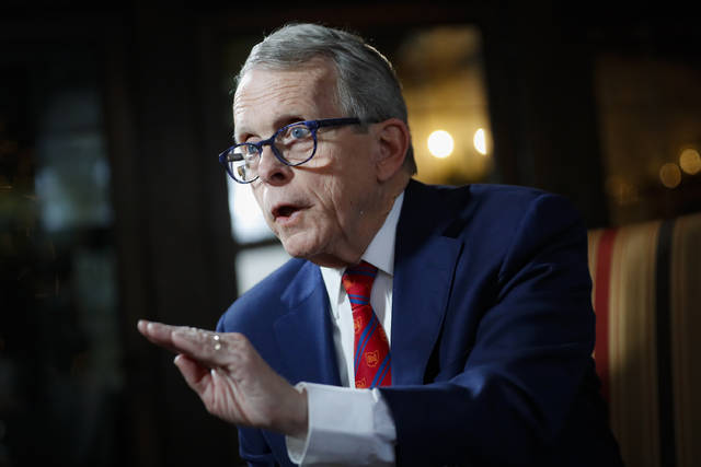 FILE - In this Dec. 13, 2019, file photo, Ohio Gov. Mike DeWine speaks during an interview at the Governor's Residence in Columbus, Ohio. DeWine tests positive for coronavirus, Friday, Aug. 6, 2020,  ahead of planned meeting with President Donald Trump. (AP Photo/John Minchillo, File)