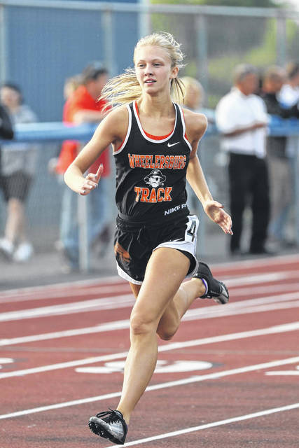 Wheelersburg's Alyssa Dingus competes in the preliminaries of the 400m dash during the 2019 Division III Southeast District track and field meet at Southeastern High School. Dingus recently announced her intention to continue her cross country and track and field careers at Shawnee State University.