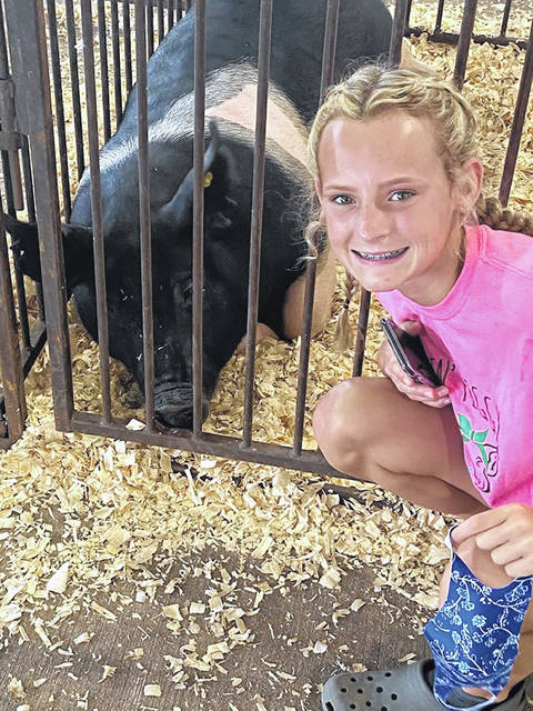 Ava Cronin, an 8th grader from Minford, with her pig Hamilton. This was Ava's first year to show pigs.