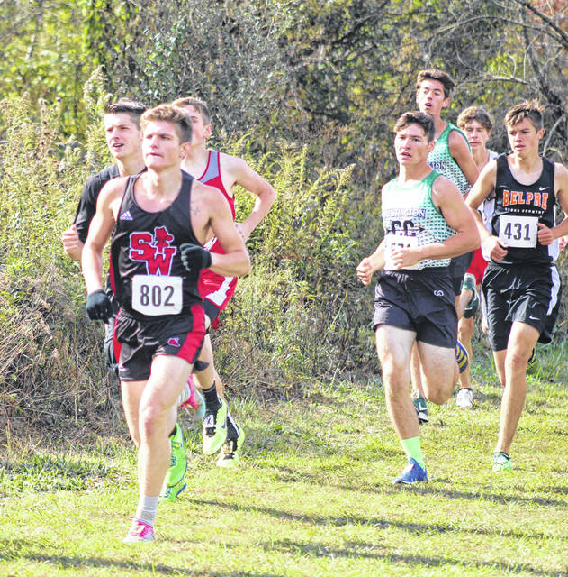 South Webster graduate Mason Blizzard (front left) competes in the Division III Southeast District cross country meet last October at the University of Rio Grande. Blizzard recently announced his intention to continue his cross country and track and field careers at Shawnee State University.