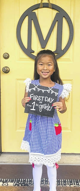 Kensley McCray as she is ready to start school after this long break, you can see she is smiling and happy to go back at Minford.