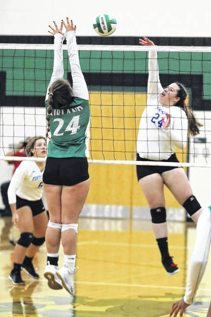 Portsmouth's Sydney Tackett (24) had 11 kills and five blocks during the Lady Trojans season-opener versus Clay on Monday.
