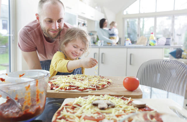 Families sticking out social distancing together can confront boredom by working together to prepare delicious, homecooked meals.