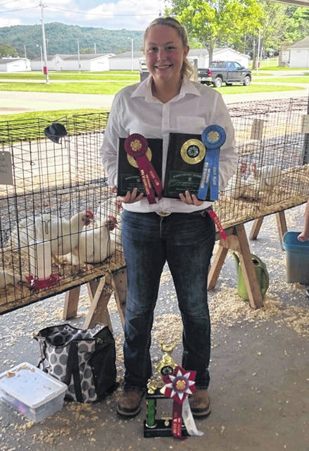 Teegan Clarkson Minford Senior, 2nd place in her class, 6th place overall market chicken, 1st place Senior skillathon, 2nd place Senior showmanship and the big trophy was for the Outstanding Poultry Exhibitor.